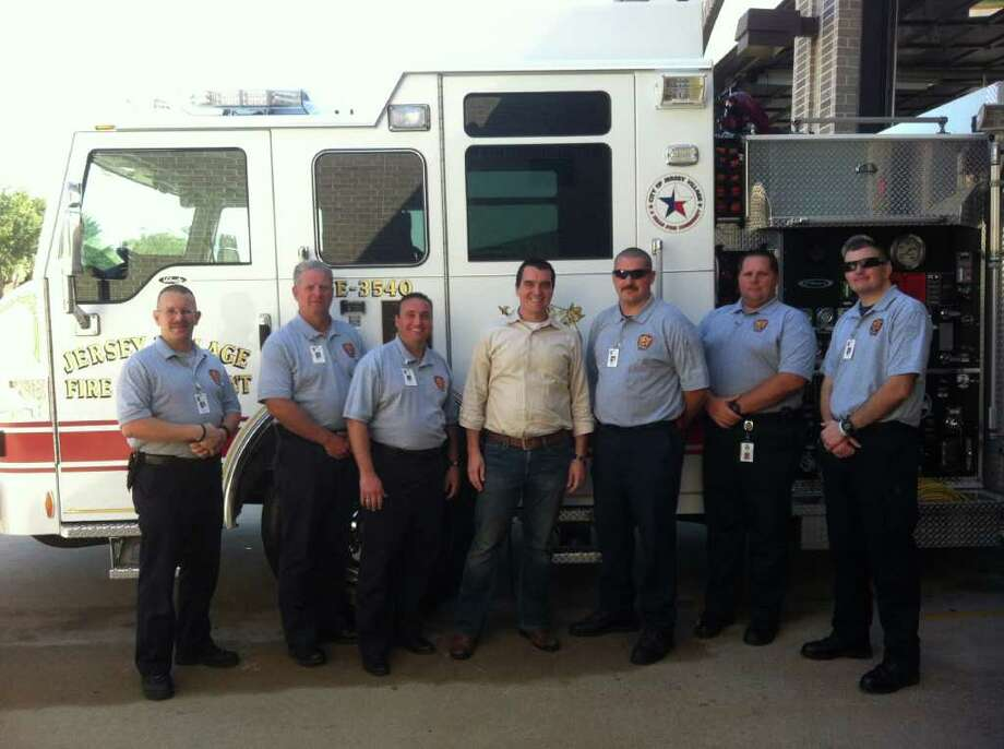 PHOTO COURTESY OF JARED MURPHY PART OF THE TEAM: Andrew Werley, center, will work as chaplain of the Jersey Village Fire Department. With him from left are: Capt. Rob Missall, Inspector Mike Bunn, Fire Chief Mark Bitz and firefighters John Nanninga, Eric Volkmann and Jay McIntire
