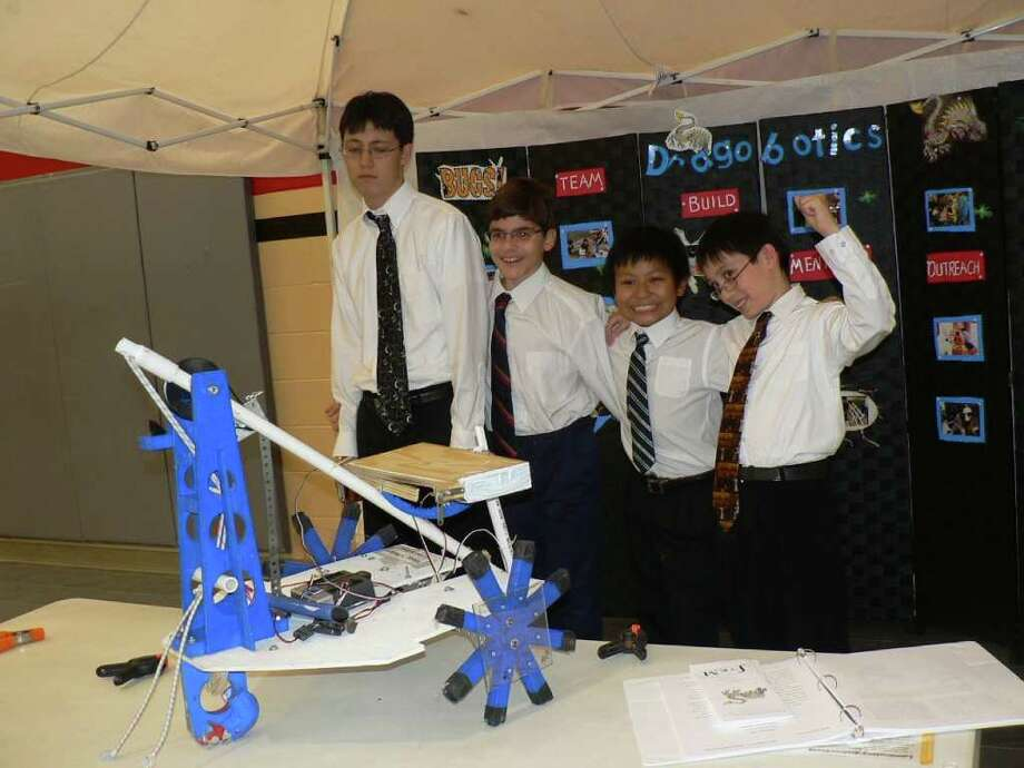 COURTESY PHOTO VICTORIOUS: BEST Robotics Champions from Young Scholars Homeschool are Alexander Whatley, left, Adam Atanas, Nicolas Xiong and Daniel Whatley, with their winning robot. Photo: Courtesy