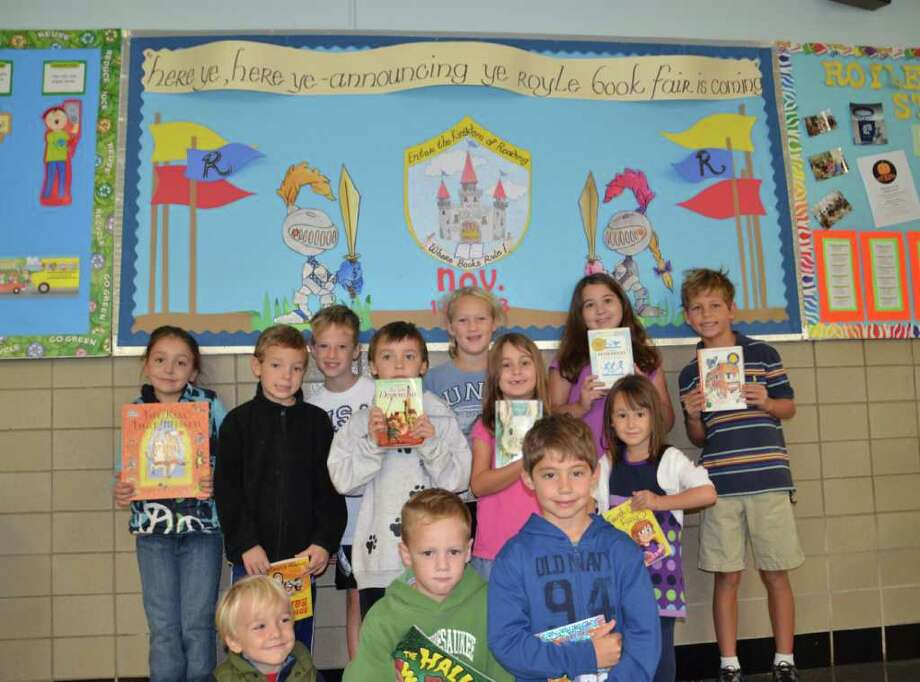 In the front row, with their new favorite books are Breck Lyon, Ned Keleghan and Matthew Dellarusso. In the second row is Ellie Lyon, Thomas Trager, Bradley Trager, Sophie Earley and Maia Wellington, back row, Kyle Bloomer, Jane Keleghan, Lilly Earley and Calvin Smith. Photo: Contributed Photo