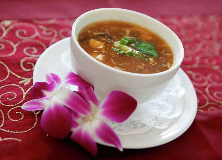 Hot and sour soup can always be found at the three Sarika's Thai restaurants. Photo: WILLIAM LUTHER, SAN ANTONIO EXPRESS-NEWS / 2011 SAN ANTONIO EXPRESS-NEWS
