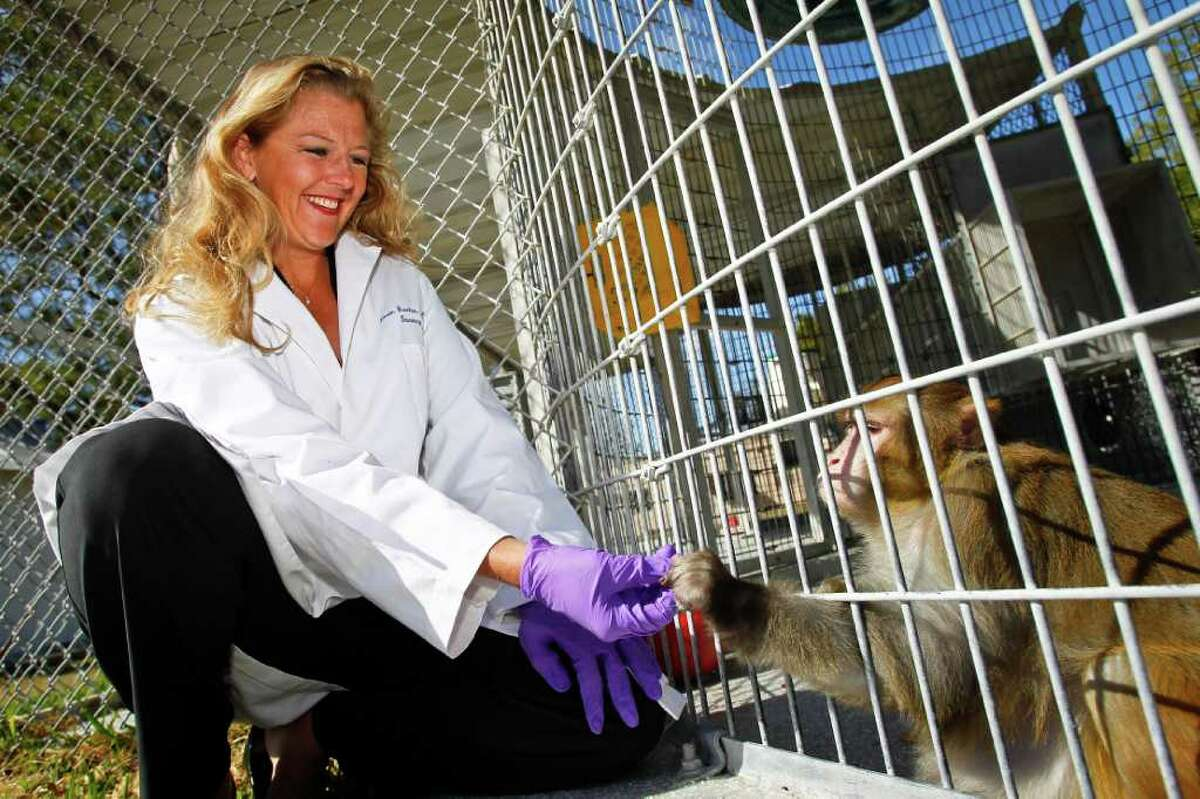 Michael Paulsen : Chronicle NUTTY BUDDIES: Dr. Kirstin Barnhart offers a peanut to one of the subjects in the M.D. Anderson weight-loss experiment. The new drug was tested at a lab near Bastrop.