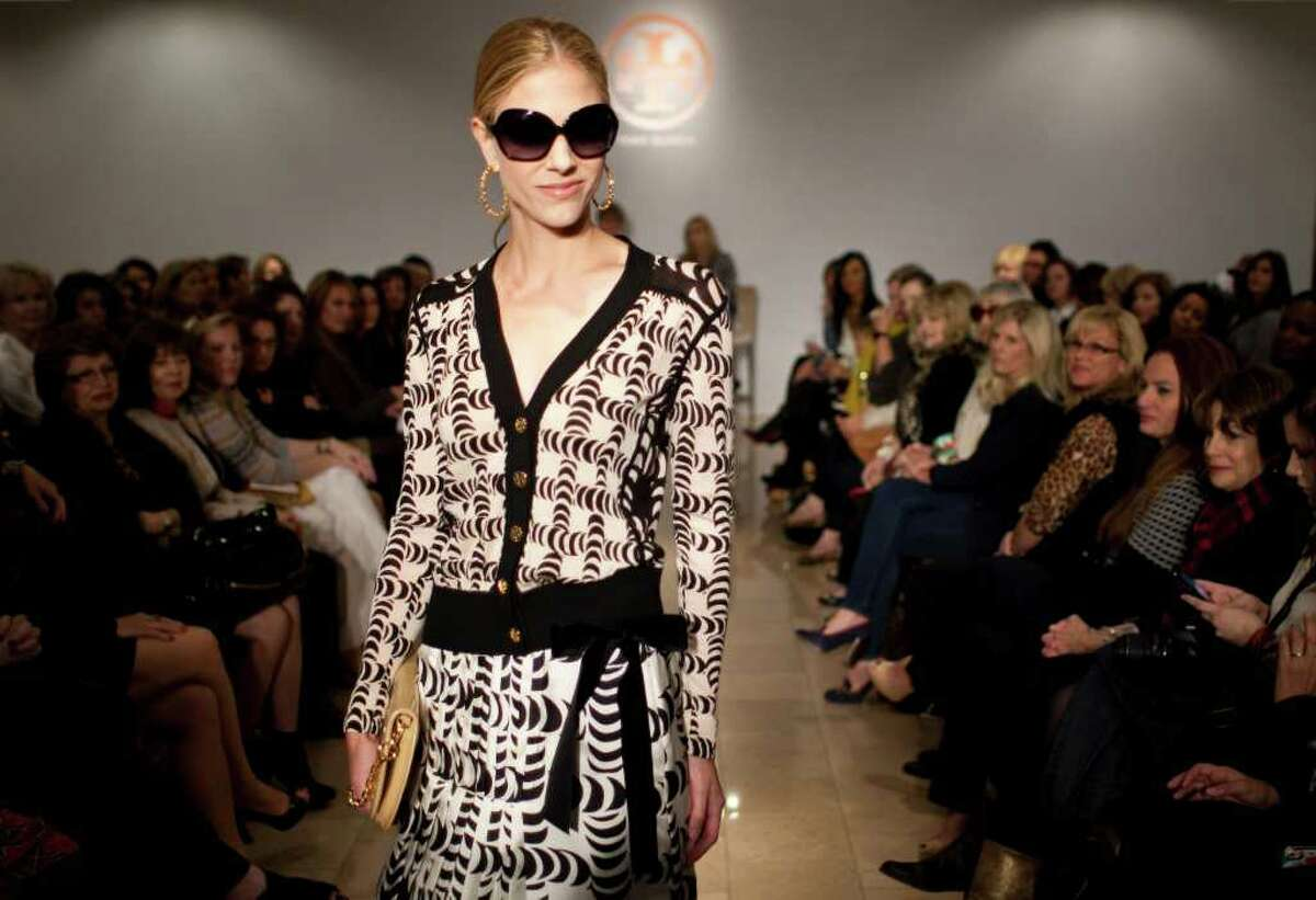 Models show Tory Burch's fall line, which includes patterns and tuxedos for women at Neiman Marcus in Houston.