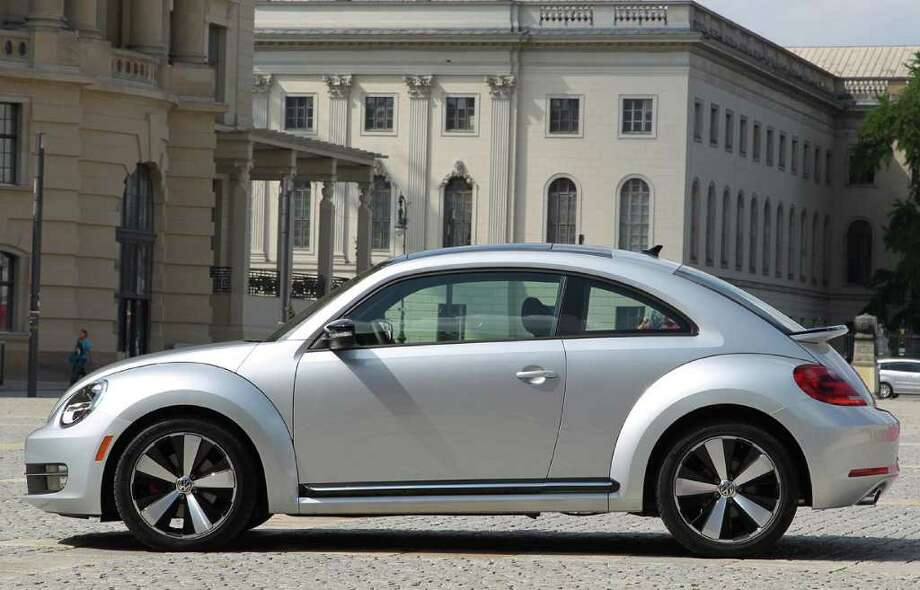 A rear-deck spoiler and fancy 18-inch alloy wheels are some of the features of the 2012 Volkswagen Beetle Turbo model, which has a 200-horsepower engine. COURTESY OF VOLKSWAGEN OF AMERICA INC. Photo: Volkswagen Of America, COURTESY OF VOLKSWAGEN OF AMERICA INC.
