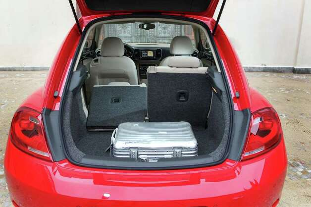 The rear hatch of the 2012 Volkswagen Beetle opens to a roomy cargo area, which can be expanded by folding down the rear seatbacks separately or together. COURTESY OF VOLKSWAGEN OF AMERICA INC. Photo: Volkswagen Of America, COURTESY OF VOLKSWAGEN OF AMERICA INC.
