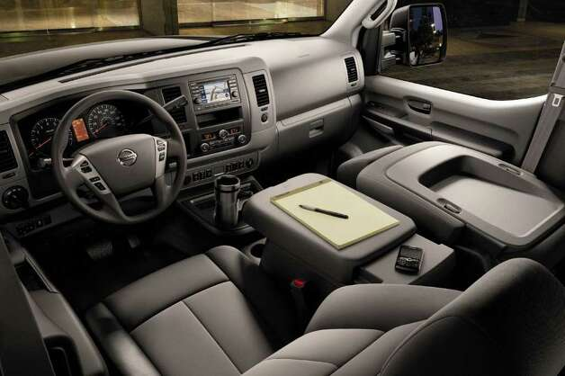 Intended for big families or commercial limo service, the 2012 Nissan NV Passenger Van can be outfitted with a variety of amenities, including a navigation system. COURTESY OF NISSAN NORTH AMERICA INC. Photo: Nissan North America, COURTESY OF NISSAN NORTH AMERICA INC.