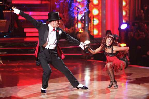 """In this Oct. 31, 2011 image released by ABC, David Arquette, left, and his partner Kym Johnson perform on the dancing competition series """"Dancing with the Stars,"""" in Los Angeles. Arquette and Johnson were eliminated from the competition on Tuesday, Nov. 1."""