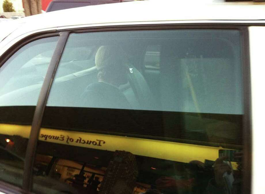 Suspect in custody in a police car at Playhouse Square Shopping Center, in Westport, Conn. Nov. 9th, 2011. Photo: Brittany Lyte
