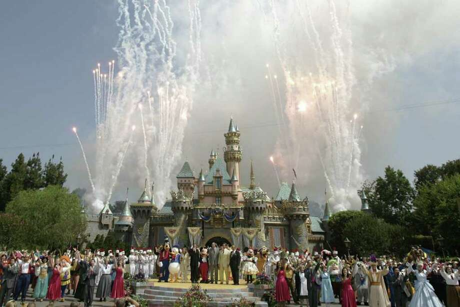 Above: Fireworks explode above the Sleeping Beauty Castle during the 50th anniversary of the opening of Disneyland in Anaheim, California, 17 July 2005. Photo: HECTOR MATA, AFP/Getty Images / 2005 AFP
