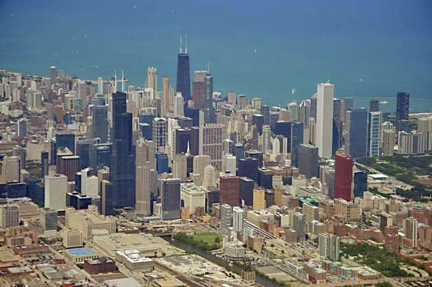 """24. Chicago: 20th for investment, 24th for development and 31st for home building. """"Still a major industrial and business area, Chicago's economy seems to have stalled. In 2013, population growth will be minimal, and many current Chicago residents are migrating away from the city. Job forecasts are negative, and the losses will total close to 200,000 since the last peak. Manufacturing and government jobs make up over 20 percent of employment, but both will struggle in the near future. As in most markets, the majority of participants rate apartments a buy. However, the other four property sectors should be put on hold next year."""" Photo: KAREN BLEIER, AFP/Getty Images / 2011 AFP"""