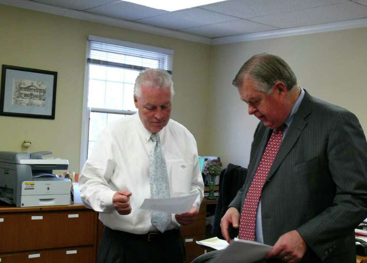 First Selectman Mike Tetreau, left, goes over some files with Fiscal Officer Paul Hiller Wednesday morning.