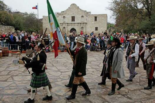 "Texian defenders of The Alamo march into Alamo plaza on the last day of The San Antonio Living History Association  ""Remembering The Alamo,"" weekend, Sunday, March 7, 2010. The event featured an Alamo cannon demonstration. Photo: JERRY LARA, San Antonio Express-News / glara@express-news.net"