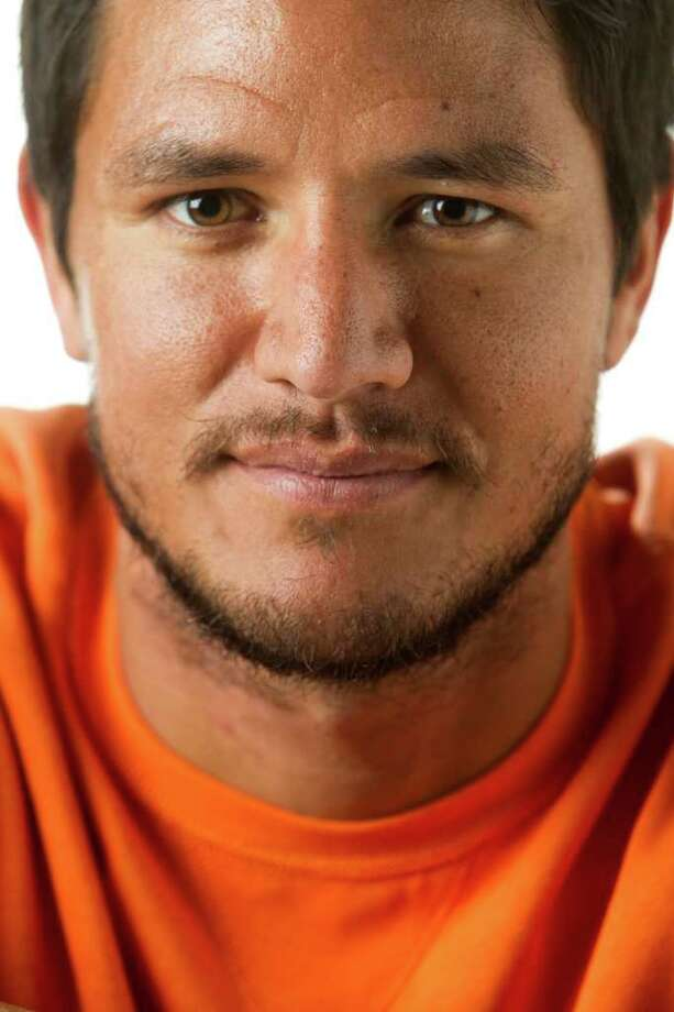 Houston Dynamo forward Brian Ching poses for a portrait in the Chronicle Studio Tuesday, Nov. 8, 2011, in Houston. Ching is shown wearing Polo by RL orange top, $125; Neiman Marcus. ( Brett Coomer / Houston Chronicle ) Photo: Brett Coomer / © 2011 Houston Chronicle