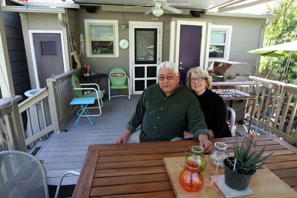 TASTE -- Linda Hamilton and Michael Rodriguez sit in their porch that is an extension of the kitchen at their Terrill Heights neighborhood house, Thursday, Nov. 3, 2011. JERRY LARA/glara@express-news.net