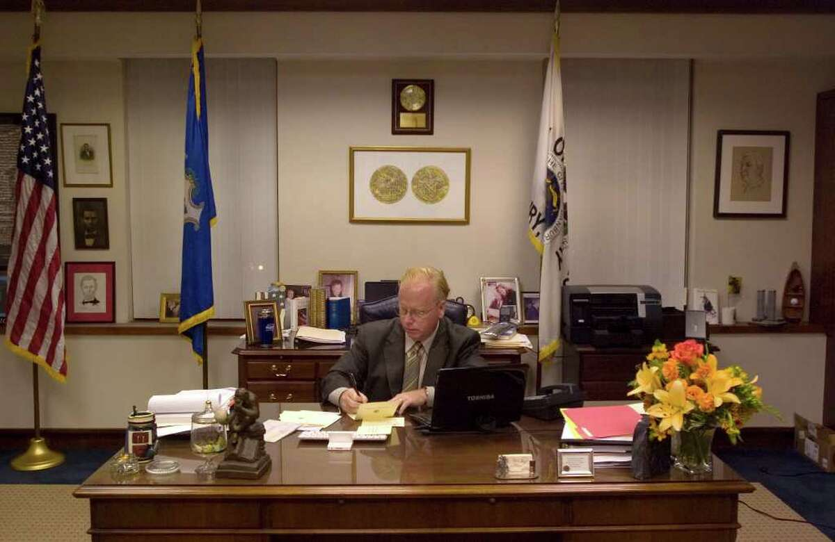 Mayor Mark Boughton writes greeting cards in his office at Danbury City Hall on Wednesday, Nov. 9, 2011.
