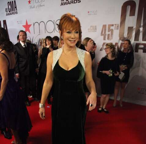 Seven members of Reba McEntire's band and her tour manager where killed in 1991 after their plane crashed south of San Diego. Guitarist Chris Austin, 27, backup singer Paula Kaye Evans, 33, bassist 