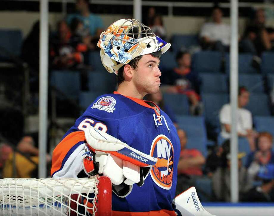 UNIONDALE, NY - SEPTEMBER 24: Kevin Poulin #60 of the New York Islanders looks at the crowd during a break in the game action in the third period of a preseason game against the New Jersey Devils at Nassau Coliseum on September 24, 2011 in Uniondale, New York. (Photo by Christopher Pasatieri/Getty Images for New York Islanders) Photo: Christopher Pasatieri, Getty Images / 2011 Getty Images