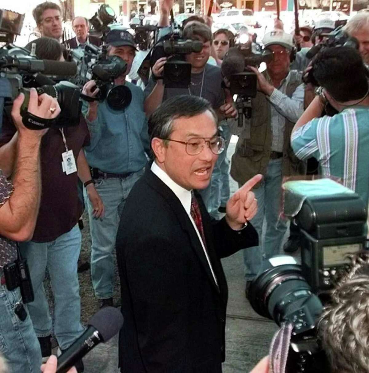 Dr. Walter Quijano, a former chief psychologist for the Texas prison system and now in private practice, talks to reporters after testifying in the punishment phase of John William King's trial Wednesday, Feb. 24, 1999, in Jasper, Texas. Quijano said King's lack of drug history and the fact that he used no weapons during previous crimes contributed to his sentiment for a life sentence. King, who was convicted of capital murder in the dragging death of James Byrd Jr., could get the death penalty for hiscrime. (AP Photo/David J. Phillip) HOUCHRON CAPTION (06/07/2000): Quijano. HOUCHRON CAPTION (06/10/2000): Clinical psychologist Walter Quijano of Conroe has testified in more than 100 capital cases. HOUCHRON CAPTION (06/15/2000): Four other cases involving sex offenders are under review by state officials because Dr. Walter Quijano or an associate was to testify as an expert witness regarding race.