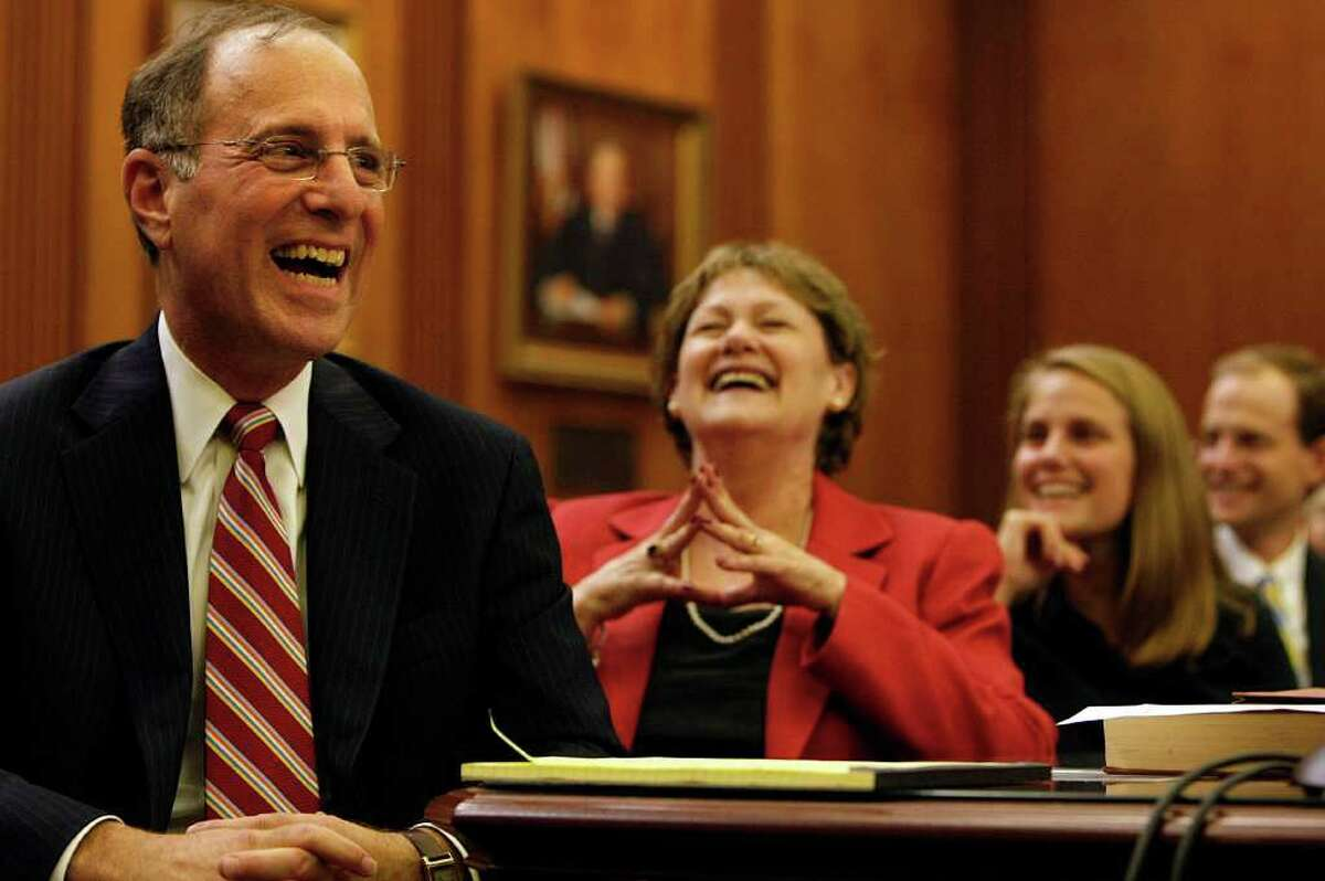 JOHNNY HANSON : CHRONICLE HED: Next to his wife Anita, Kenneth Magidson laughs during his investiture as U.S. Attorney for the Houston-based Southern District of Texas at the Bob Casey U.S. Courthouse Wednesday, Nov. 2, 2011, in Houston. ( Johnny Hanson / Houston Chronicle )