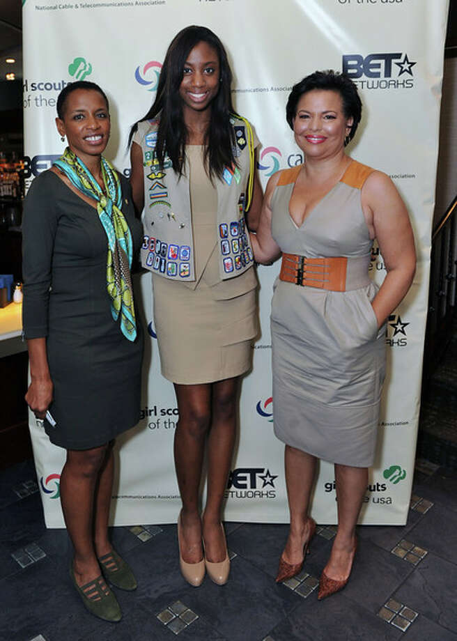 NAME: Jillian Ross--  Credit: Girl Scouts of San Jacinto Council  Girl Scout Ambassador Jillian Ross (center) stands between Congresswoman Donna F. Edwards (left) and Debra Lee, chairman and CEO of Black Entertainment Television (BET) Networks (right) during a luncheon hosted by Girl Scouts of the USA (GSUSA) in partnership with BET at the Congressional Black Caucus Annual Legislative Conference in Washington, D.C.  Jillian was the only girl representative on the panel that discussed leadership in girls and findings from the Girl Scout Research Institute's (GSRI's) new study, The Resilience Factor: A Key to Leadership in African American and Hispanic Girls.  Jillian will be a guest speaker at the GSUSA National Convention in Houston, November 10-13. / Girl Scouts of San Jacinto Counc