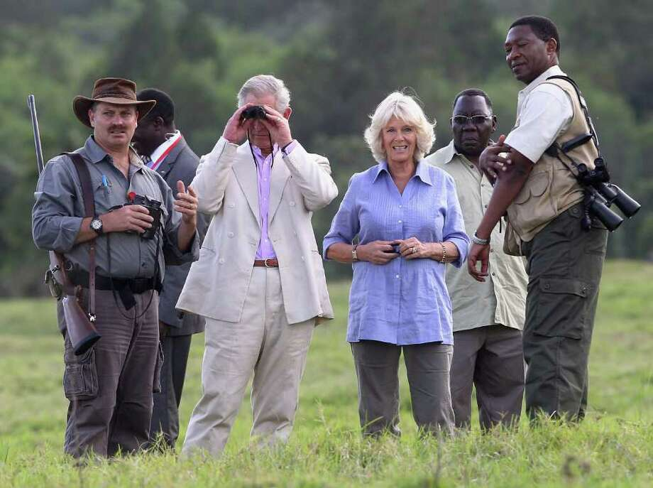 Camilla, Duchess of Cornwall and Prince Charles, Prince of Wales walks with the Honary Consul in Arusha Richard Beatty in Arusha National Park on November 9, 2011 in Arusha, Tanzania. Photo: Chris Jackson, Getty / 2011 Getty Images
