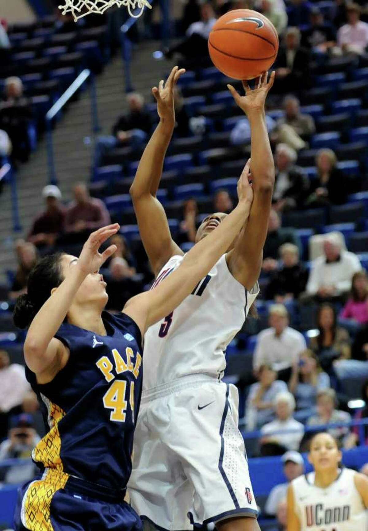 UConn's Tiffany Hayes, right, reaches for a loose ball as Pace's Maral Javadifar defends in the first half of an exhibition game on Wednesday in Hartford.