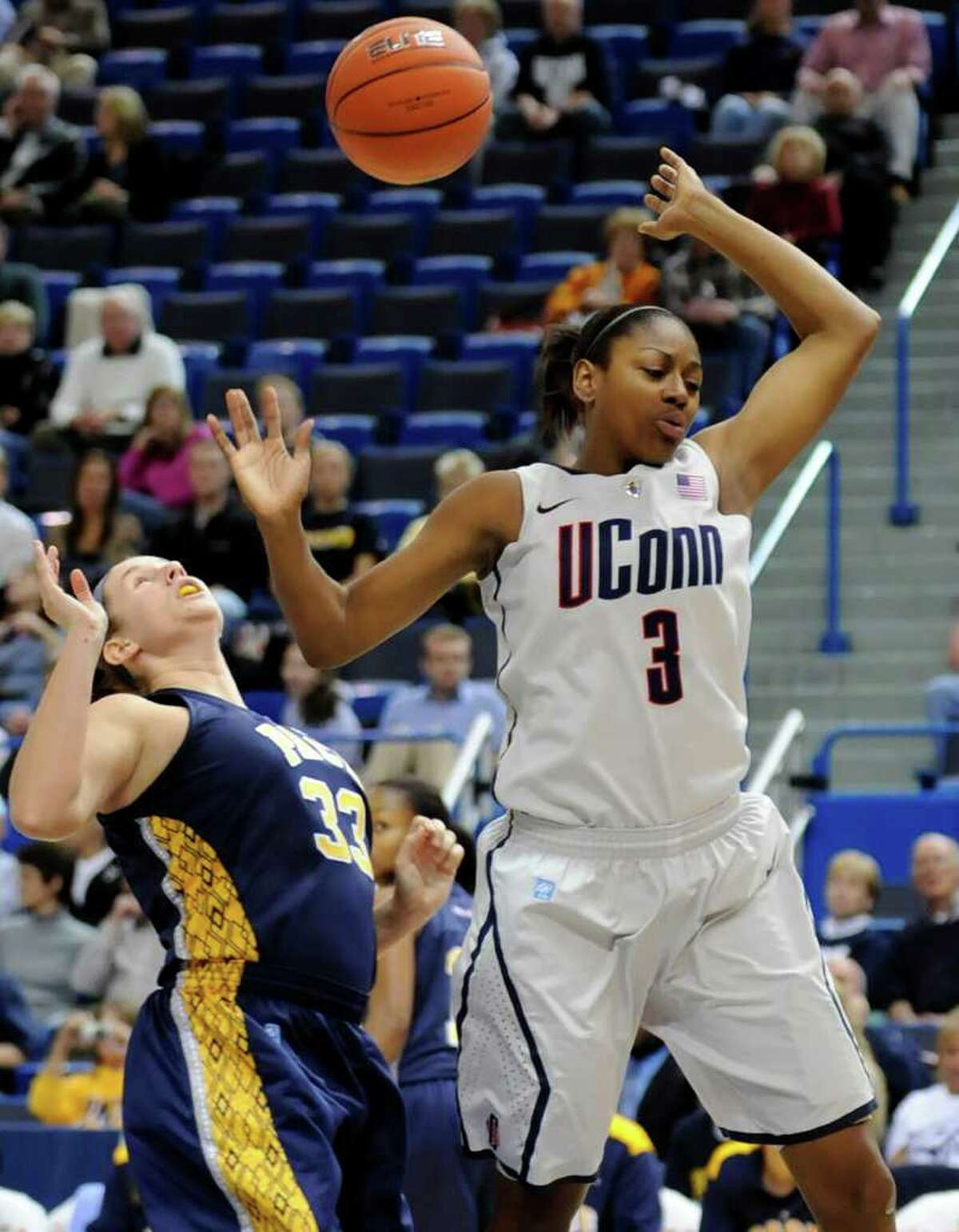 UConn's Tiffany Hayes and Pace's Kerri White, left, battle for a rebound in the first half of an exhibition game Wednesday in Hartford.