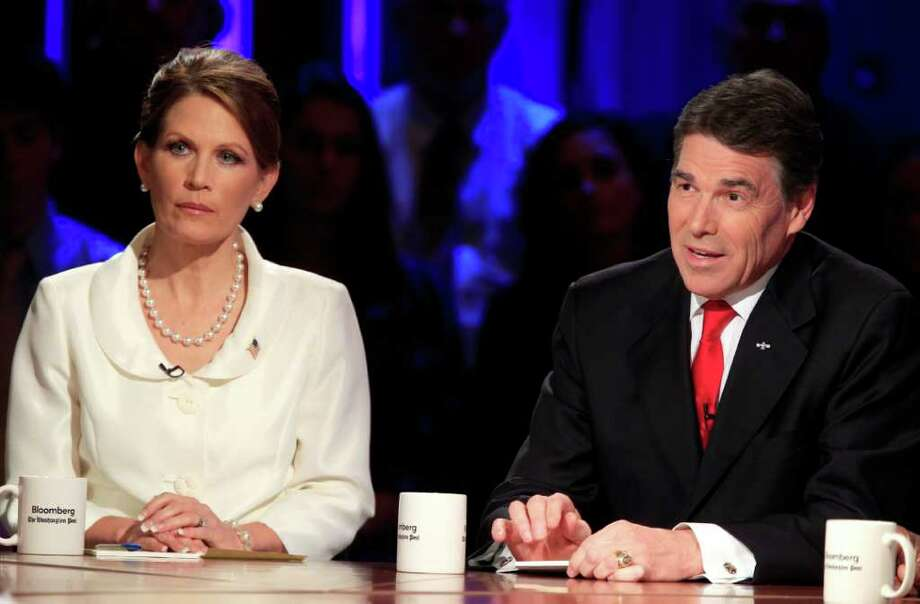 Republican presidential candidates Rep. Michele Bachmann, R-Minn., and Texas Gov. Rick Perry participate in a presidential debate at Dartmouth College in Hanover, N.H., Tuesday, Oct. 11, 2011. (AP Photo/Andrew Harrer, Pool) Photo: Andrew Harrer, POOL