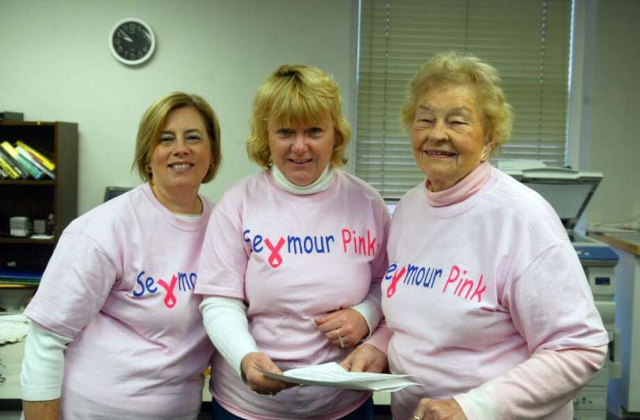 In the Seymour Town Clerk's office, assistant town clerks (L-R) Susan DeBarber, Elizabeth Conrad and Town Clerk Esther Rozum wore pink t-shirts for Seymour PInk Day. Employees throughout town hall wore the pink shirts. Pink Day is the brain child of Seymour High School teacher Mary Deming. The idea was to raise community awareness about breast cancer, Wednesday, Oct.21, 2009. Photo: Phil Noel / Connecticut Post