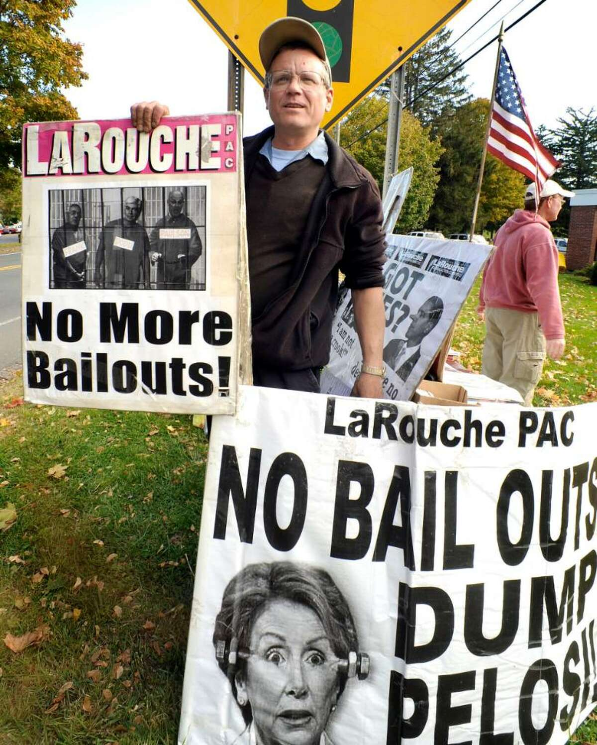 Bob Wasser of the LaRouche Political Action Committee displays protest signs to passing motorists in New Fairfield on Tuesday, Oct.20,2009.