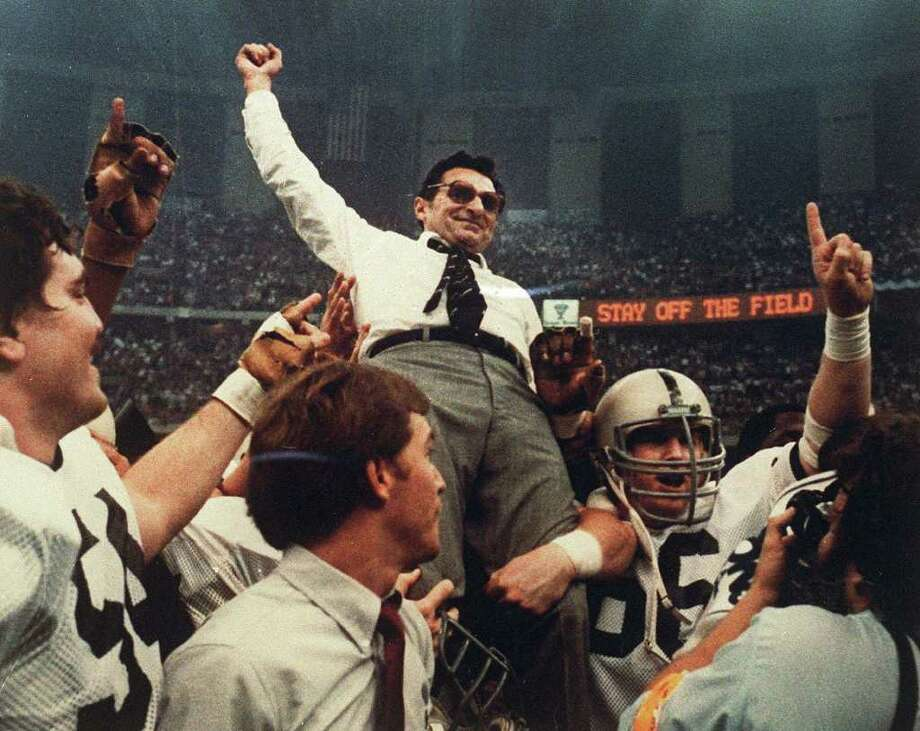 FILE - In this Jan. 2, 1983 file photo, Penn State football coach Joe Paterno celebrates as he is carried off the field after a 27-23 victory against Georgia in the Sugar Bowl,  to claim the national championship, at the Superdome in New Orleans. Paterno say he plans to retire at the end of the season, his long and illustrious career brought down because he failed to do all he could about an allegation of child sex abuse against a former assistant.  (AP Photo/File) Photo: FILE / AP1983