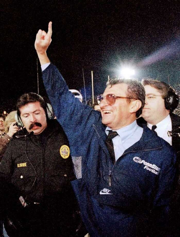 FILE - In this Jan. 2, 1995 file photo, Penn State head coach Joe Paterno smiles as he celebrates his team's victory over the University of Oregon in the Rose Bowl college game in Pasadena, Calif.  Paterno say he plans to retire at the end of the season, his long and illustrious career brought down because he failed to do all he could about an allegation of child sex abuse against a former assistant.  (AP Photo/Reed Saxon, File) Photo: Reed Saxon / AP1995