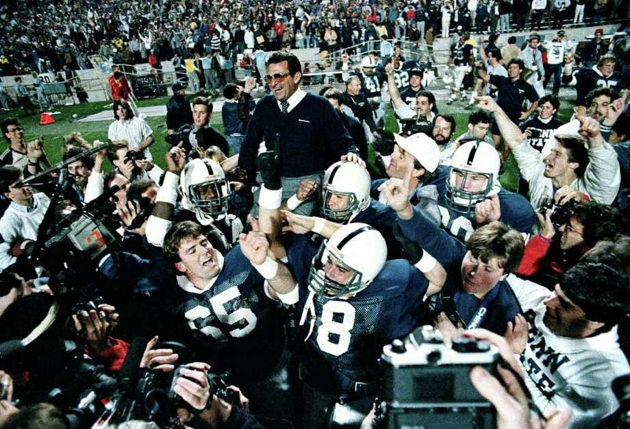 FILE - In this Jan. 2, 1987 file photo, Penn State coach Joe Paterno is carried after defeating Miami, 14-10,  in the Fiesta Bowl, to win the national championship, in Tempe, Ariz. Paterno say he plans to retire at the end of the season, his long and illustrious career brought down because he failed to do all he could about an allegation of child sex abuse against a former assistant. (AP Photo/Jim Gerberich, File) Photo: JIM GERBERICH / AP1987