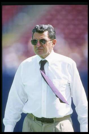 EAST RUTHERFORD, NJ - FILE:  Coach Joe Paterno of the Penn State Nittany Lions stands on the sidelines during a game against the Temple Owls at Giants Stadium on September 21, 1996 in East Rutherford, New Jersey.  According to reports on November 9, 2011, Paterno will step down as head coach at the end of the season amid allegations that former assistant Jerry Sandusky was involved with child sex abuse. (Photo by Al Bello/Allsport) Photo: Al Bello