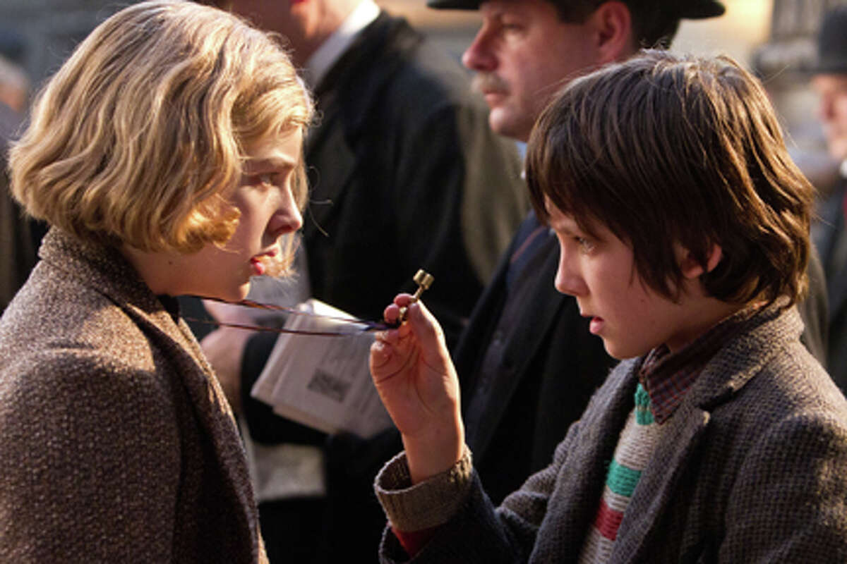 Chloe Grace Moretz as Isabelle and Asa Butterfield as Hugo Cabret in