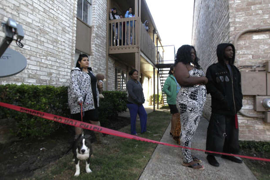 Tenants watch as firefighters extinguish a blaze at Sterling Crossings apartment complex. (Cody Duty / Chronicle)