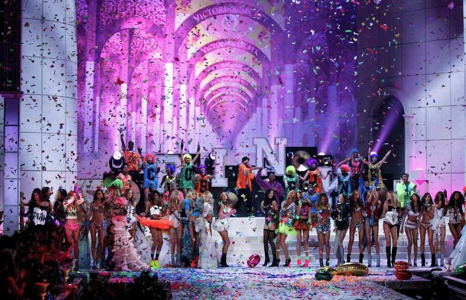 Models celebrate after presenting creations during the Victoria's Secret Fashion Show at the Lexingt