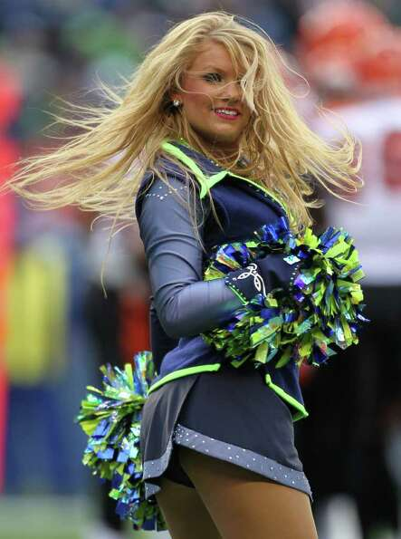 A Sea Gal performs prior to the game against the Cincinnati Bengals at CenturyLink Field on October
