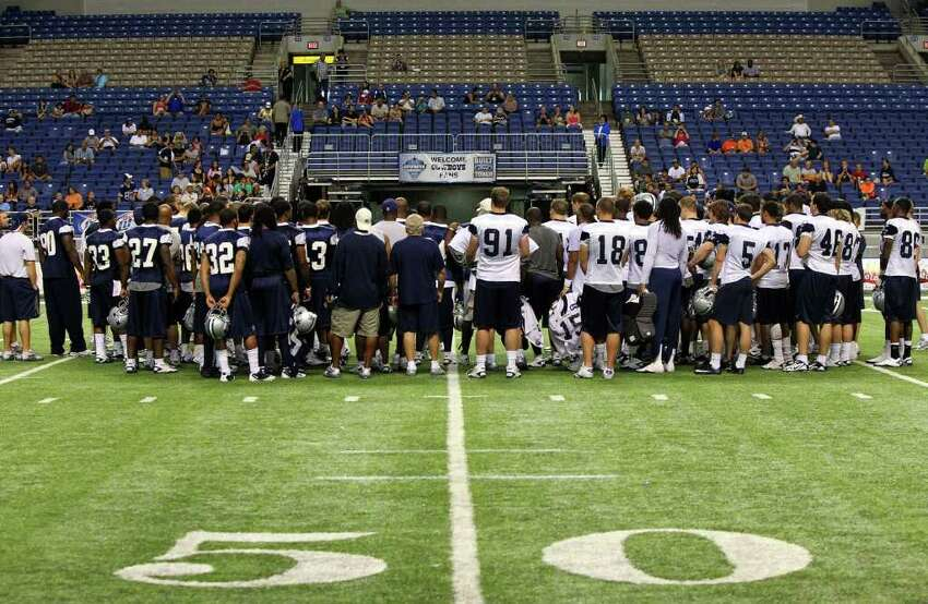 The Dallas Cowboys huddle together for the last time of the 2011 training camp at the Alamodome Wednesday August 10, 2011. The Cowboys will play their first preseason game against Denver Thursday August 11. JOHN DAVENPORT/jdavenport@express-news.net