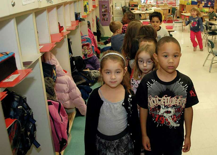 Ava Bonilla, Carlos Jimenez and the rest of Bettina Takacs' kindergarten students at Julia A. Stark School in Stamford, Conn. line up to head to art class on Thursday Nov. 10, 2011. As the number of children in the city under age 5 increases, the school system is looking at the potential impact on future elementary class sizes. Photo: Cathy Zuraw / Stamford Advocate