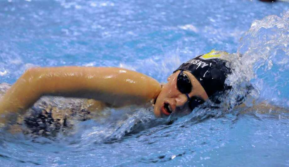 Weston's Lauren Solinsky competes in the 200 Yard Freestyle Event during the Girls SWC 2011 Championship meet at Masuk High School in Monroe on Monday Nov. 7, 2011. Photo: Lisa Weir / The News-Times Freelance