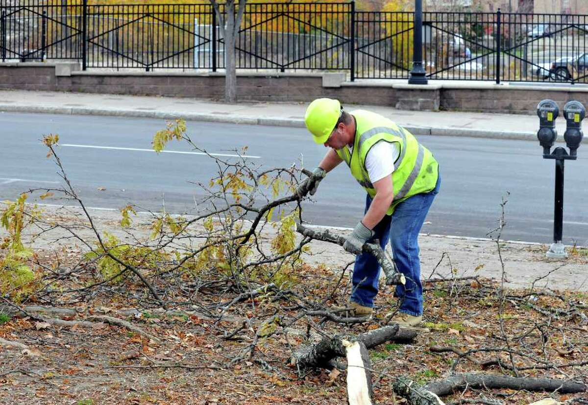 Bobby Cowan, of the Danbury Highway Department, clears brush from Kennedy Park Thursday, Nov. 10, 2011. Many area towns will begin residental brush removal next week.