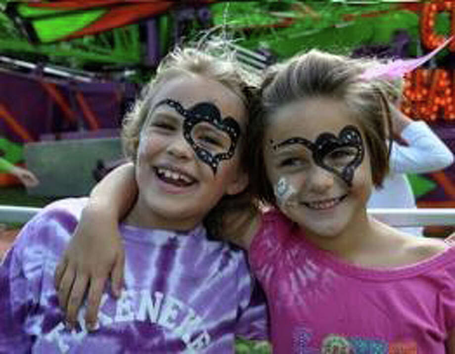 Many visited Tokeneke Elementary school in October to celebrate the season and enjoy the rides and festivities at the Pumpkin Carnival. Face painting was offered. Photo: Contributed Photo