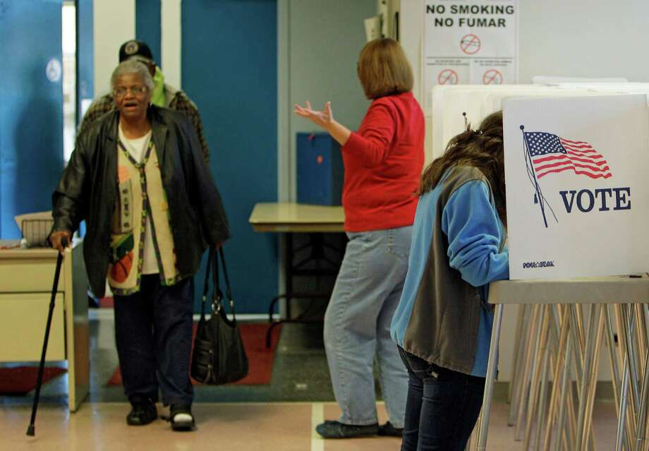 Voters take advantage of the last day of early voting at the Cuyahoga County Board of Elections, Friday, Nov. 4, 2011, in Cleveland. Statewide ballot questions, including a politically charged collective-bargaining issue, have amped up off-year election early voting. Photo: Mark Duncan, AP / AP