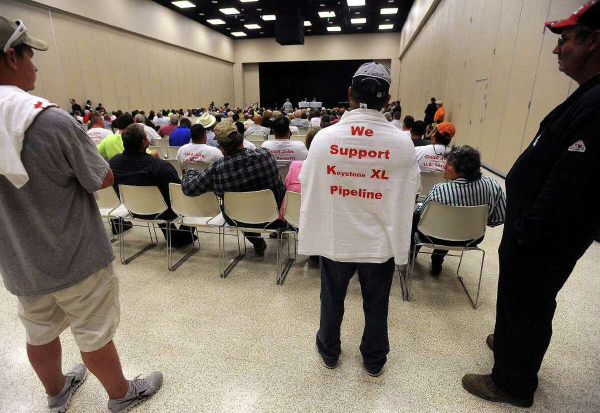 Workers wearing anti-OPEC shirts listen during the U.S. State Department's open hearing for the proposed Keystone XL Pipeline at the Port Arthur Civic Center Monday, Sept. 26, 2011. If constructed, the planned pipeline would connect TransCanada tar sands to refineries in Port Arthur and Houston. Hundreds attended the event to show support of the jobs that the pipeline's construction would bring to the area. TransCanada has estimated that the project could create 20,000 U.S. jobs. Guiseppe Barranco/The Enterprise