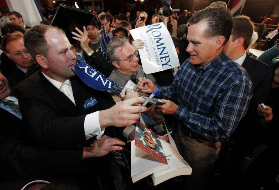 Republican presidential candidate, former Massachusetts Gov/ Mitt Romney signs autographs after speaking at the American Polish Cultural Center in Troy , Mich.,Thursday, Nov. 10, 2011. Photo: AP