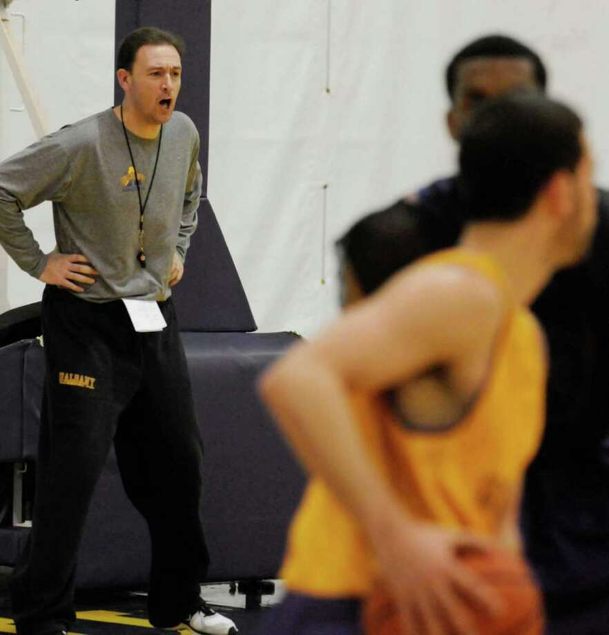 University at Albany head men's basketball coach Will Brown,left, watches his team practice in Albany, NY Tuesday, Nov.1, 2011.( Michael P. Farrell/Times Union) Photo: Michael P. Farrell