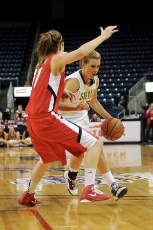 Siena's Maja Gerlyng is guarded by Fairifeld's Brittany MacFarlane during Friday's MAAC Tournament quarterfinal game at Webster Bank Arena at Harbor Yard on March 4, 2011. Photo: Lindsay Niegelberg / Connecticut Post