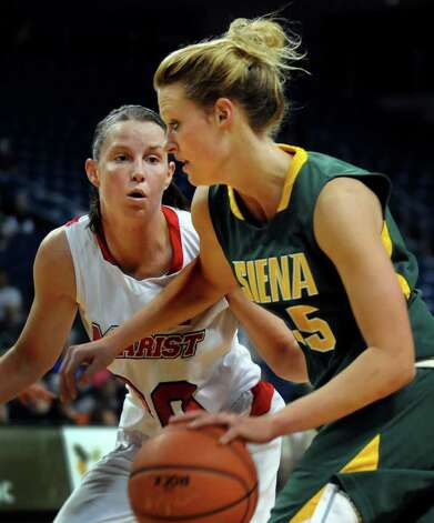 Siena's Maja Gerlyng (35), right, controls the ball as Marist's Erica Allenspach (30) defends during their basketball game at the MAAC Championships on Saturday, March 5, 2011, at Webster Band Arena at Harbor Yard in Bridgeport, Conn. (Cindy Schultz / Times Union) Photo: Cindy Schultz