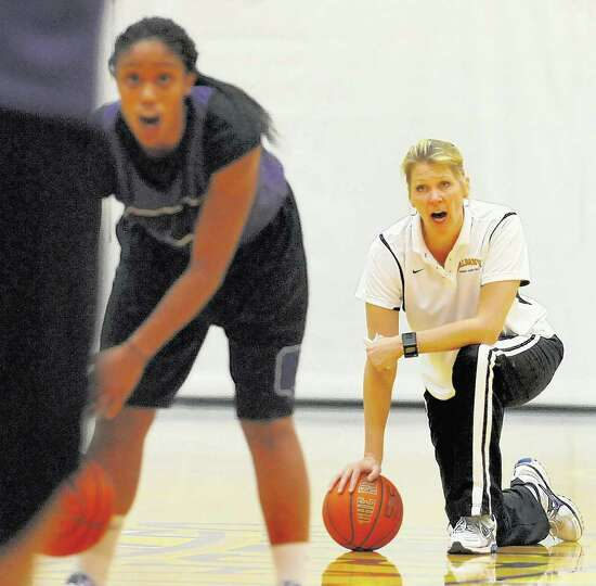 UAlbany women's basketball coach Katie Abrahmanson-Henderson, right, works with her team during a sc