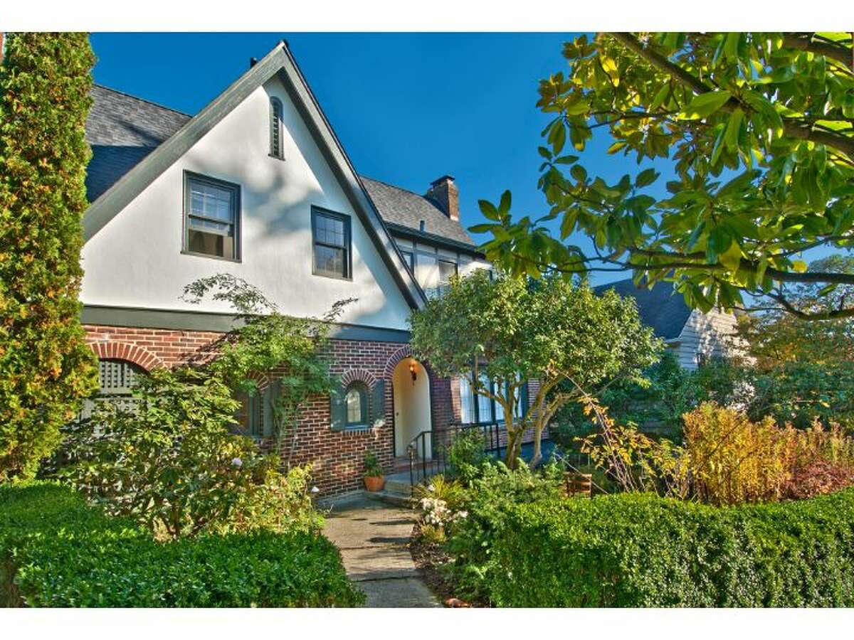 Front of 1516 40th Ave. The 3,460-square-foot brick Tudor, built in 1925, has four bedrooms, three bathrooms, coved ceilings, arched doorways, leaded glass, built-in cabinets a finished basement with a rec room and bar, two fireplaces and three decks, with views of Lake Washington and Mount Rainier. It sits on a 6,000-square-foot lot and is listed for $1.595 million.